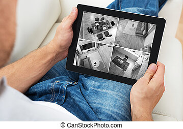 Person Watching News On Digital Tablet