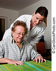 Pfleger old woman in a nursing care