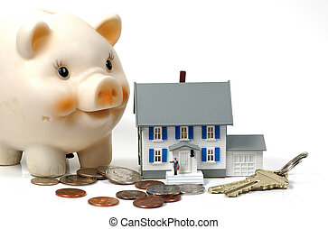 Photo of a Model Home, Piggy Bank and Money. Mortgage, Insurance and Related Concepts.