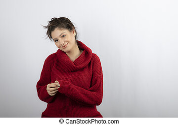Photo of a pretty young woman in warm red sweater posing