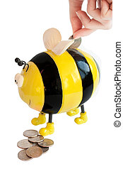 photo of the isolated on white bee moneybox with woman hand inserting coin