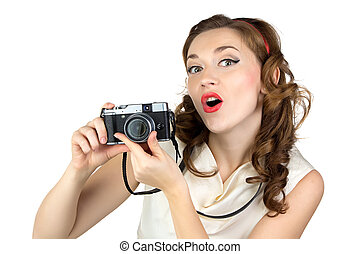 Photo of the surprised woman with retro camera