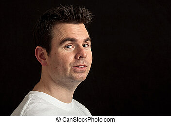 portrait of male in his 30's on black background