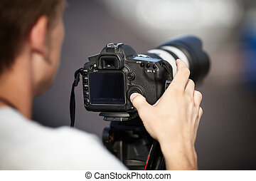 Paparazzi concept ,selective focus on camera