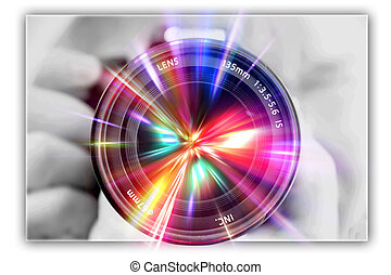 photographing lens in the hands of the photographer