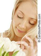 picture of cheerful blond with white tulips