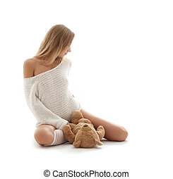 lovely blond in white sweater with teddy bear