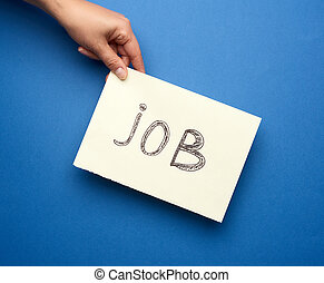 piece of paper with the inscription job, concept of unemployment