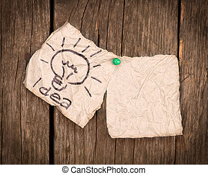 pieces of paper with the word idea on a wooden background