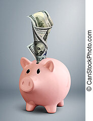 Piggy bank with dollar on grey background