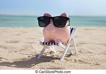 Piggy Bank On Deckchair With Sunglasses