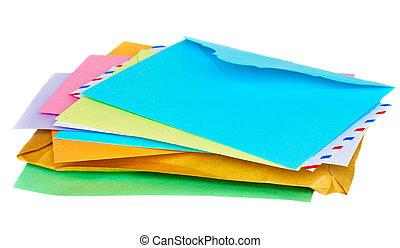 pile of colorful envelopes isolated on white background