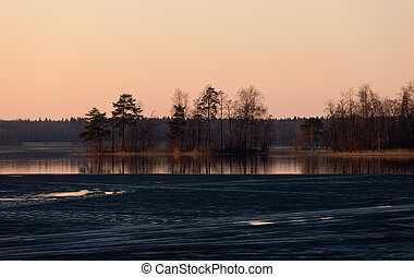 Sunset on wood lake in the spring