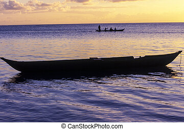 Pirogue at the sunset