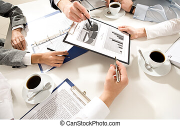 Image of human hands during discussion of business plans