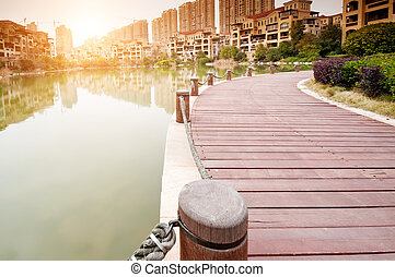 platform beside lake with sunset in park