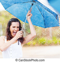 playful young woman in the rain