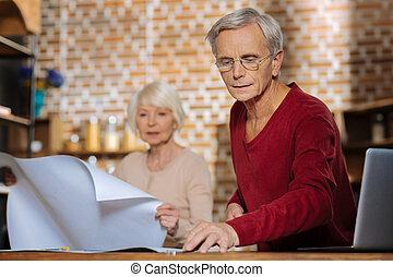 Pleasant senior man working