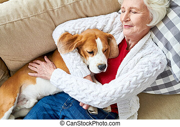 Pleased owner sleeping with dog