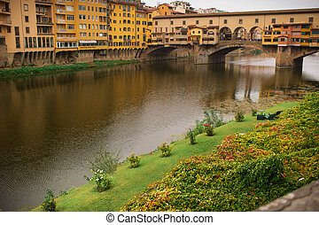 Ponte Vecchio view from Lungarni with Arno river, Spring Sunset in Florence - Italy