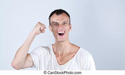 Portrait happy man celebrates success smiling . Financial freedom achievement