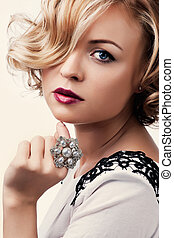 portrait of a beautiful girl with a pearl ring