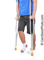 portrait of a broken foot using crutch trying to walk isolated on white background