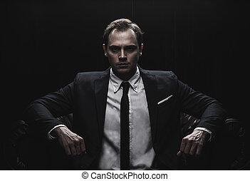 Portrait of a businessman on black background