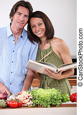 portrait of a couple cooking