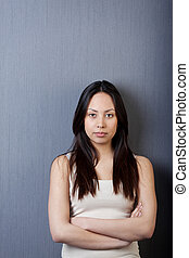 portrait of asian girl with folded arms