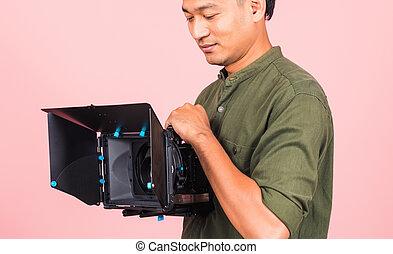 adult man confident professional videographer handheld holding digital video camera