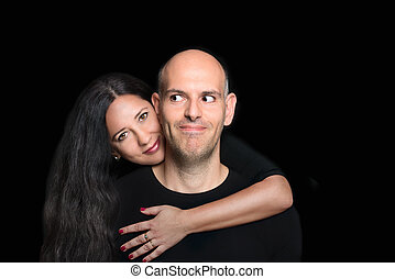 Portrait of couple in love on black background