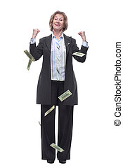Portrait of excited mature woman under a money rain
