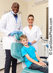 dental team with little patient