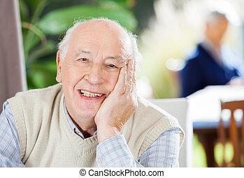 Portrait Of Happy Senior Man At Nursing Home