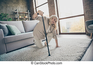 Portrait of her she nice attractive ill gray-haired granny trying to get up leaning on stick feeling bad suffering at industrial brick loft modern style interior house apartment