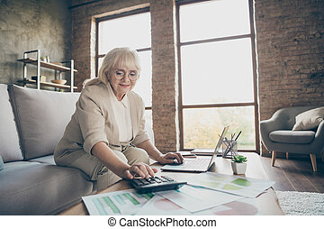 Portrait of her she nice attractive smart clever experienced qualified gray-haired business lady financier calculating company balance at industrial brick loft modern style interior house apartment