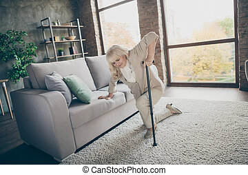 Portrait of her she nice attractive weak lonely gray-haired granny trying to get up leaning on cane feeling bad healthcare at industrial brick loft modern style interior house apartment