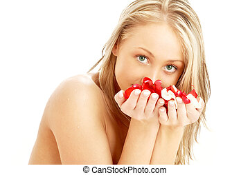 lovely blond in spa with red and white rose petals