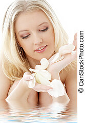 lovely blond with white rose petals in water