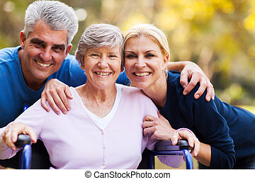 mid age couple and senior mother