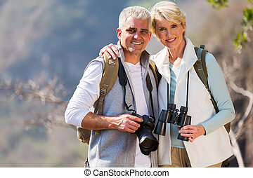middle aged couple hugging in mountain