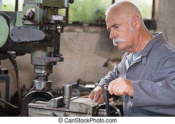 portrait of milling-machine senior operator