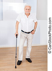 Portrait Of Senior Man With Walking Stick