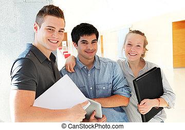 Portrait of students in school corridor