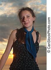 girl against the sunset sky