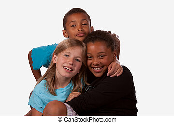 Portrait of three children, two girls and one boy of mixed ethnicity