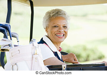 Portrait Of Woman Sitting In A Golf Cart