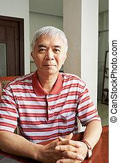 Positive elderly Chinese man