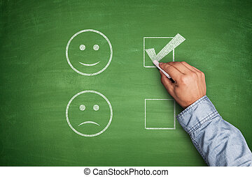 Positive Feedback on green blackboard with hand